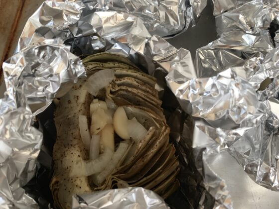 foil wrapped artichokes with one opened
