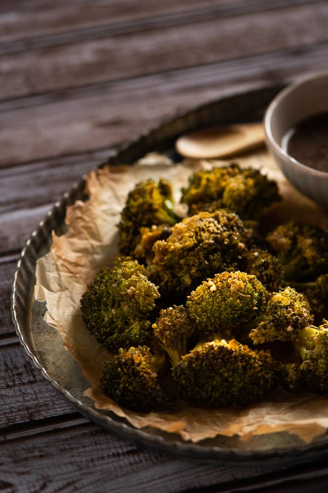 broccoli and sauce on metal tray