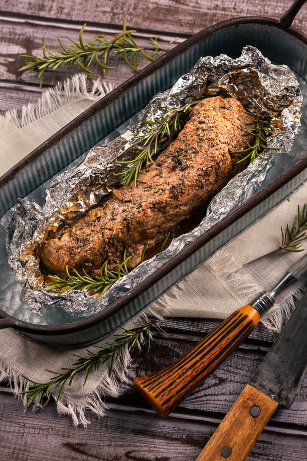 Pork Tenderloin in open foil in oblong tin serving tray