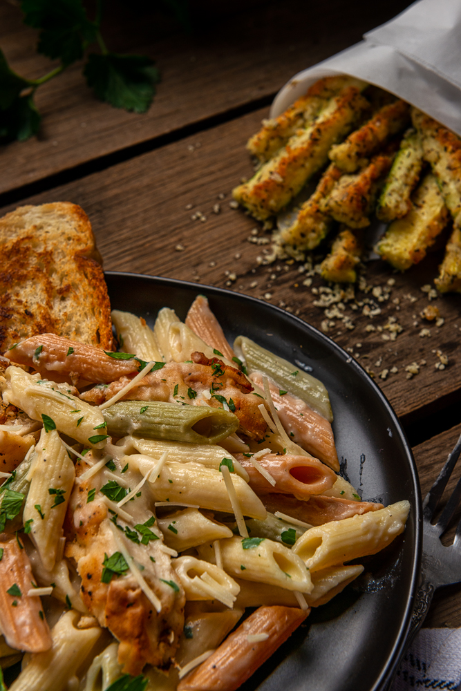 Plate of pasta, and zucchini.