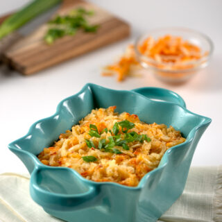 Serving bowl of hash brown casserole.