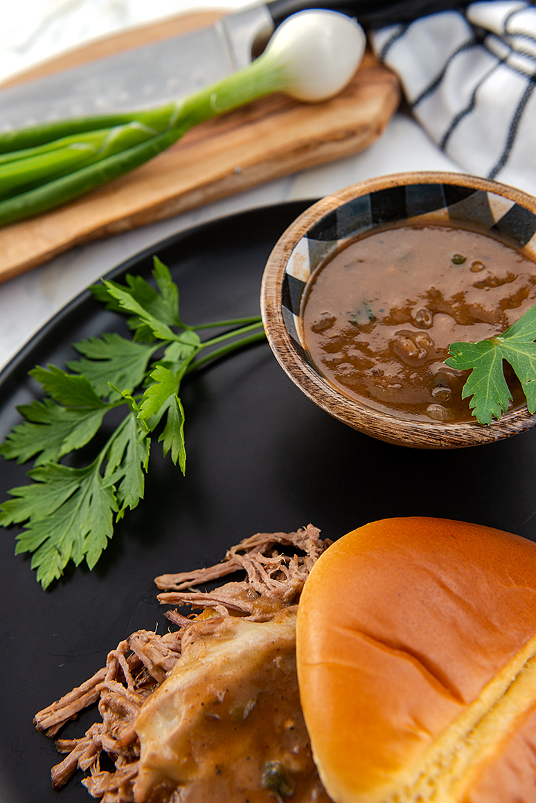 gravy gravy and more gravy photo of french dip sandwich and chopping board, knife and scallion