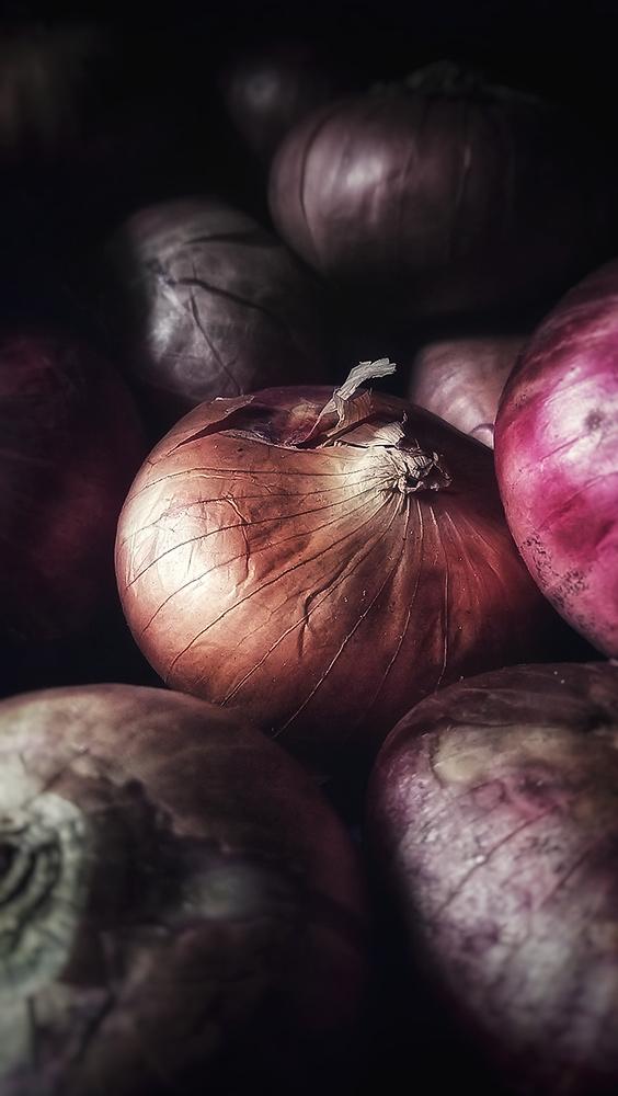 A bin of onions