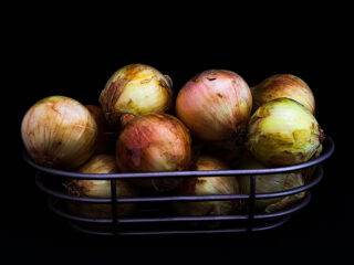 metal basket filled with onions
