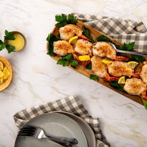 Tray of prepared parmesan shrimp
