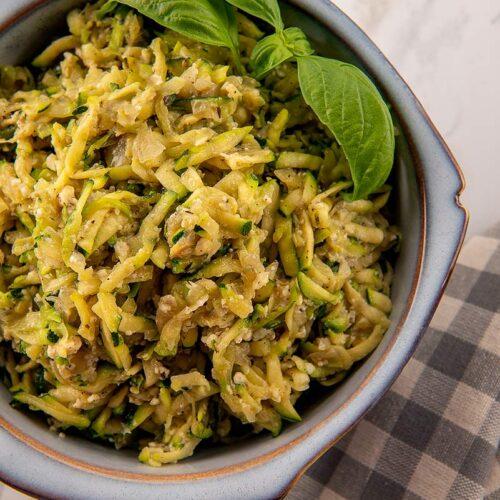 A bowl of shredded zucchini.